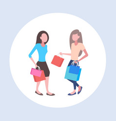 women holding colorful paper bags couple girls vector image