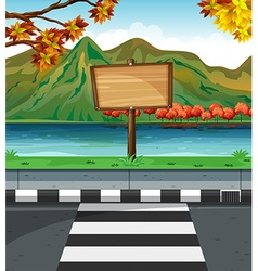 Wooden sign along the road vector image vector image