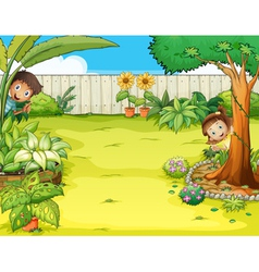 A boy and a girl hiding in the garden vector