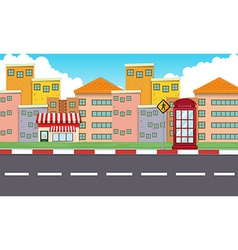 Buildings along the empty road vector image