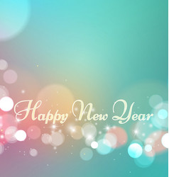 Happy new year on bokeh light background vector