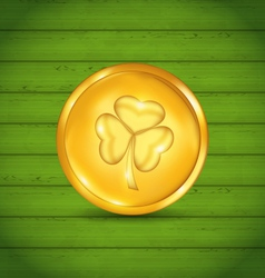 Golden coin with clover on green wooden texture vector image