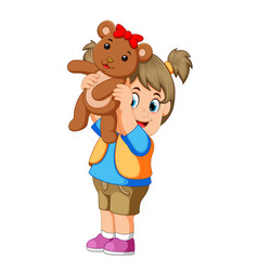 a girl happy play with thw brown teddy bear vector image