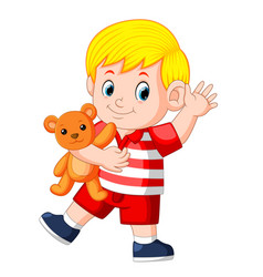 a cute boy play with the orange teddy bear vector image