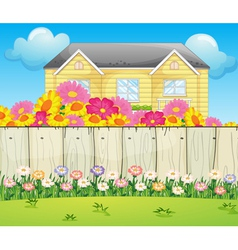A house surrounded with colorful flowers vector image
