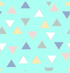 Soft triangles in pastel shades on mint green vector
