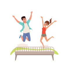 happy romantic couple jumping on the bed vector image