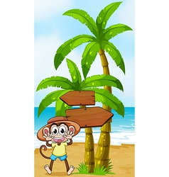 A monkey at the seashore near the wooden vector image
