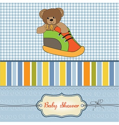 Baby shower card with teddy bear hidden in a shoe vector
