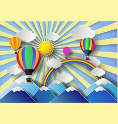 Hot air balloon over mountain vector