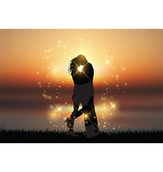 Couple kissing against a sunset background vector image
