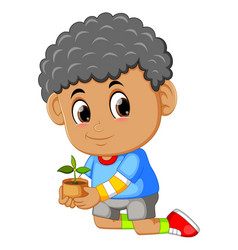 a boy carrying seeding for planting in soil vector image