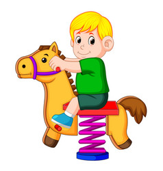 a boy happy play with brown horse toy vector image
