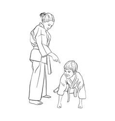 Young karate boy and girl vector
