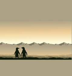 Silhouette penguin on mountain background scenery vector
