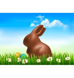 Chocolate bunny with easter eggs in grass vector image vector image