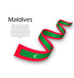 Waving ribbon or banner with flag of maldives vector