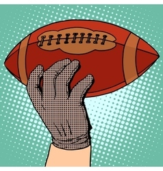 ball of american football in his hand vector image
