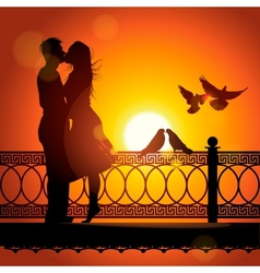 Silhouette of couple in love kissing at sunset vector image vector image