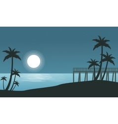 Silhouette of seaside with moon landscape vector