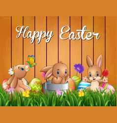 happy easter bunnies on a background fence vector image