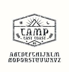 Rustic serif font and camping emblem vector
