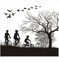 family cycling in the countryside vector image vector image