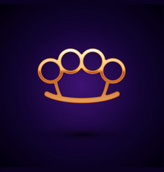 Gold brass knuckles icon isolated on dark blue vector