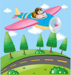 Pilot flying aeroplane over field vector