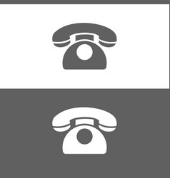 classic phone icon on a dark and white background vector image