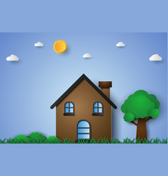 House in green field with grass and tree paper vector