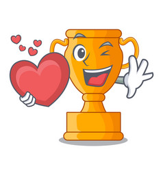 with heart champion golden trophy on cartoon table vector image