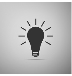 light bulb flat icon on grey background vector image