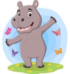 cartoon happy hippo posing in grass vector image