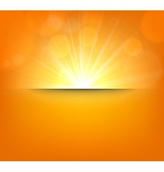 Blurry orange background with lens flare vector