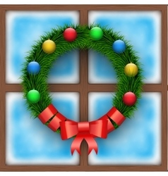 Frosted window with Christmas wreath vector