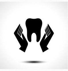 hand holding a tooth icon vector image