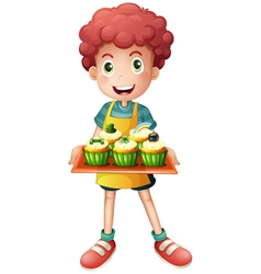 A young baker holding a tray with cupcakes vector