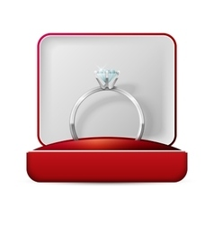 Wedding rings in a gift box on white vector