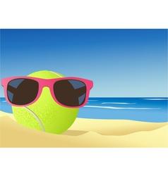 Tennis ball on the beach sand vector image vector image