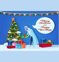 arab man putting gift box under fir-tree happy new vector image