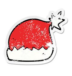 distressed sticker of a cartoon santa hat vector image