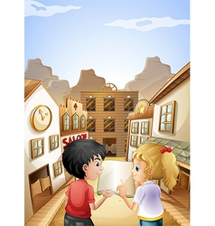 A boy and a girl with an empty book talking near vector