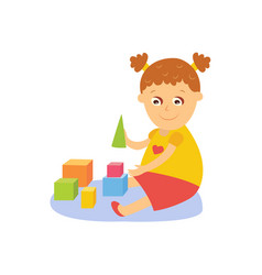 little girl playing with wooden blocks vector image