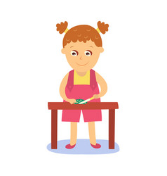 Girl cooking cutting cucumber on kitchen table vector
