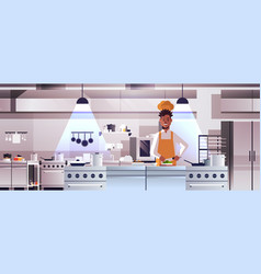 Male professional chef cook chopping vegetables vector