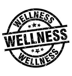 Wellness round grunge black stamp vector