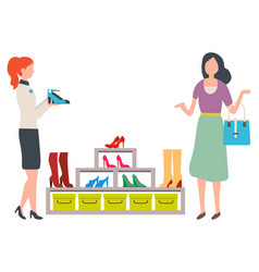 woman choosing shoes in fashion boutique vector image
