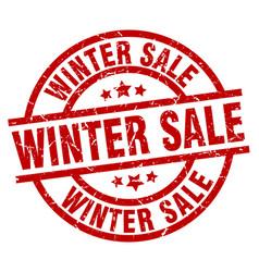 Winter sale round red grunge stamp vector