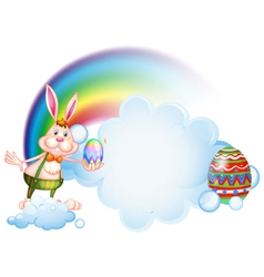 A bunny holding an egg near the rainbow vector image vector image